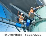 group of workers cleaning... | Shutterstock . vector #532673272