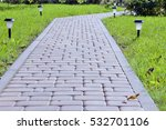 Paved Garden Path Through A...