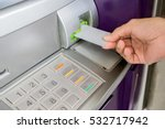 Man Is Inserting Card To Atm...