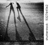 shadow of two people play... | Shutterstock . vector #532764562