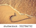 Heart Drawn On The Beach Sand...