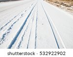 Car Tire Track In Snow