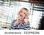 Beautiful Woman Sings With A...