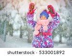 little girl in snow blizzard... | Shutterstock . vector #533001892