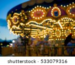 Blurred Light Of Carousel At...