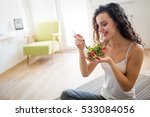 beautiful woman eating healthy... | Shutterstock . vector #533084056