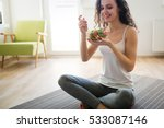 woman eating healthy salad... | Shutterstock . vector #533087146