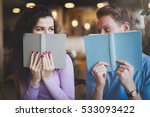 Stock photo shy couple in love flirting while studying 533093422