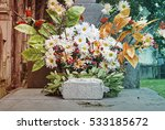 Vase With Artificial Daisy In...