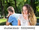 sad young couple sitting on the ... | Shutterstock . vector #533244442