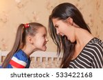 Small photo of Mother and daughter make each other terrible faces