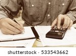young man using calculator and... | Shutterstock . vector #533543662