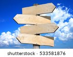 empty wooden signpost with four ... | Shutterstock . vector #533581876