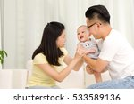 asian parent playing with their ... | Shutterstock . vector #533589136
