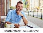 happy man having coffee break... | Shutterstock . vector #533600992
