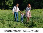 cheerful parents walking in the ... | Shutterstock . vector #533675032