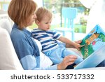 mother reading book to her baby ...   Shutterstock . vector #533717332