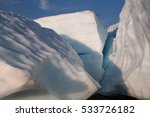 Small photo of Clumps of layered ice in disarray. Moma Mountains. Yakutia. Russia.