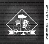 Handyman Logo On  Brick Wall...