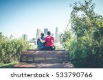 Small photo of Homosexual couple at a romantic date outdoors - Gay couple in love flirting and having fun