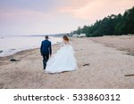beautiful couple on the beach... | Shutterstock . vector #533860312