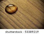 Water Drop On A Wooden Surface.