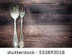 old spoon and fork on brown... | Shutterstock . vector #533893018