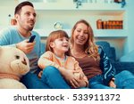 young family watching tv... | Shutterstock . vector #533911372