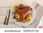 Roast Duck With Apples On Plat...