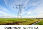 Power Lines And Pylons In A...