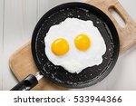 fried eggs meal in a frying pan ... | Shutterstock . vector #533944366