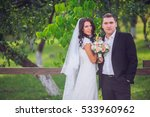 bride and groom in a park... | Shutterstock . vector #533960962