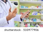 pharmacist filling prescription ...   Shutterstock . vector #533977906