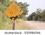 Small photo of rusty old right Curve Sign