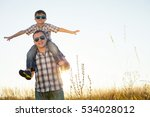 father and son playing on the... | Shutterstock . vector #534028012