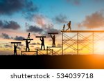 silhouette adults helped build... | Shutterstock . vector #534039718