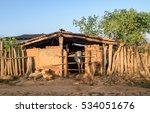 Small photo of A village cow barn where a cow stands.