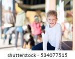 smiling positive boy sitting at ... | Shutterstock . vector #534077515