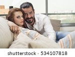 happy couple sitting on a couch ... | Shutterstock . vector #534107818
