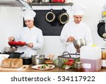 two glad female and male cooks... | Shutterstock . vector #534117922