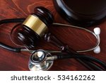 Gavel And Stethoscope On A...