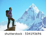 Small photo of Hiker with backpacks reaches the summit of mountain peak. Success, freedom and happiness, achievement in mountains. Active sport concept.