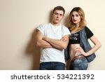 fashion couple posing in studio. | Shutterstock . vector #534221392