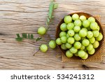 Indian Gooseberry On A Wooden...