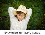 little boy blond in a straw hat ...   Shutterstock . vector #534246532