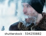 young man smokes an electronic... | Shutterstock . vector #534250882