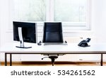 Stock photo modern empty office space desk with computer phone and chair concept of corporate job vacancy 534261562
