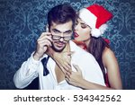 sexy santa woman seduce young... | Shutterstock . vector #534342562