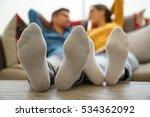 Closeup Of Couple's Feet Laid...