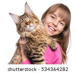 Stock photo happy little girl hugging lovely kitten cute ten year old child playing with her cat isolated on 534364282